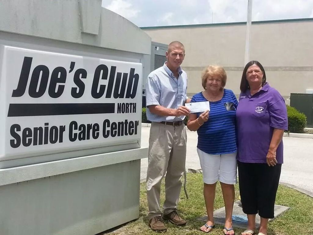08-01-2014 Nancy & Sharon behalf of Auxiliary present $1,000.00 check to Joe's Club