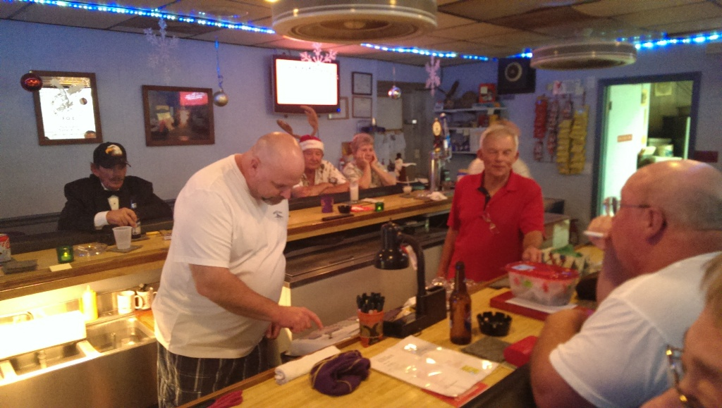 12-21-2013 Tommy helps Gil with beverage prices and Bob enjoys this time bartending